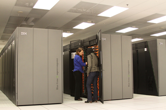 2 personnel inspecting IBM super computer